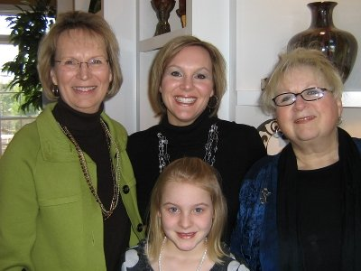 Sara Riley, her mom and both grandmothers all dressed up for Mama Mia.