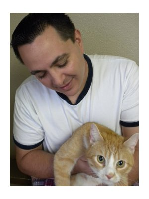Cat lover, Michael, with beautiful Benicio.  Don't tell his Chihuahua Bambi he's a cat lover!