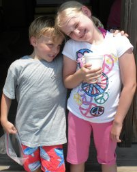 Sara Riley and Charlie are in such a good mood at Pirate's Cove that they love on each other.