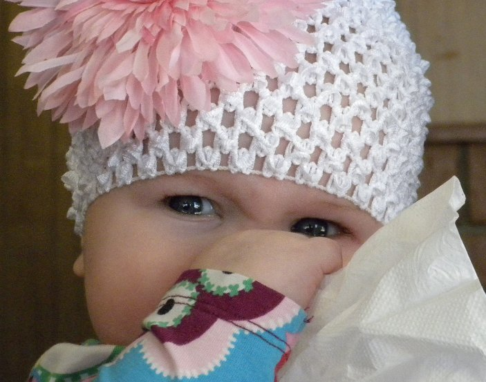 Itty Bitty loves her hat with a pink bow.