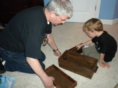 Charlie investigates the secret compartment of his new box.