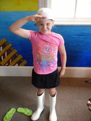 Shrimp Boots and a sailor cap fill out the uniform.